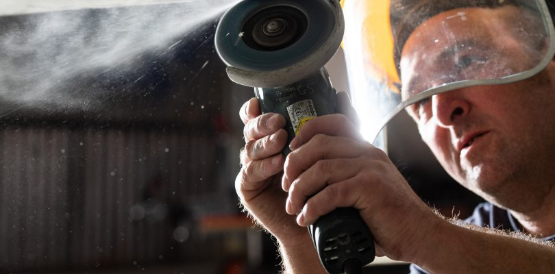 A boat gelcoat repair technician