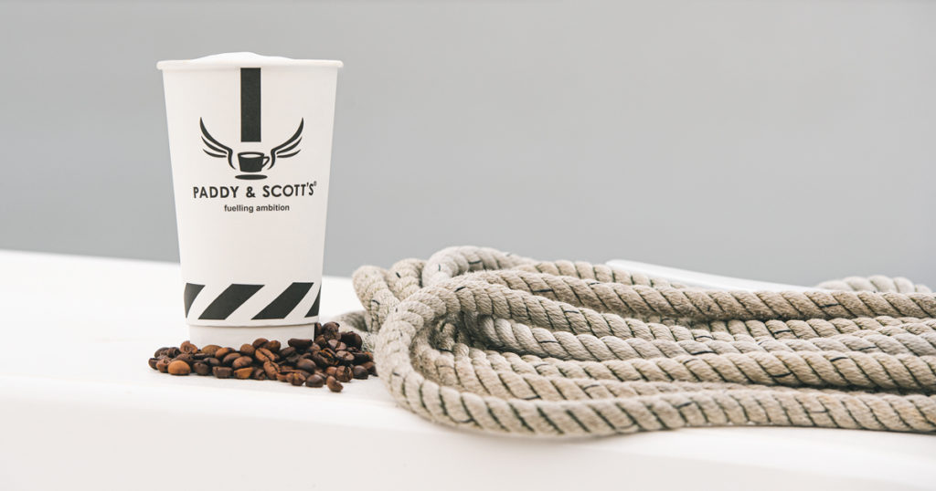 A Paddy and Scott coffee cup on a Broom Boat
